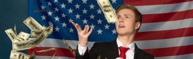 man throwing cash on tribune on american flag background