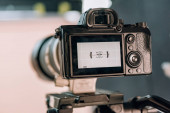Selective focus of electronic level on camera display in photo studio