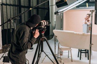 Cameraman filming beautiful woman in photo studio stock vector