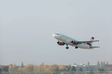 Flight departure of jet plane above airport runway stock vector
