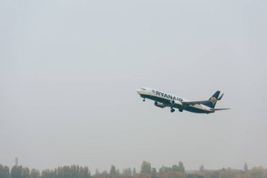 KYIV, UKRAINE - OCTOBER 21, 2019: Departure of airplane of ryanair airline in cloudy sky stock vector