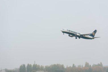KYIV, UKRAINE - OCTOBER 21, 2019: Jet plane of ryanair airline taking off in cloudy sky stock vector