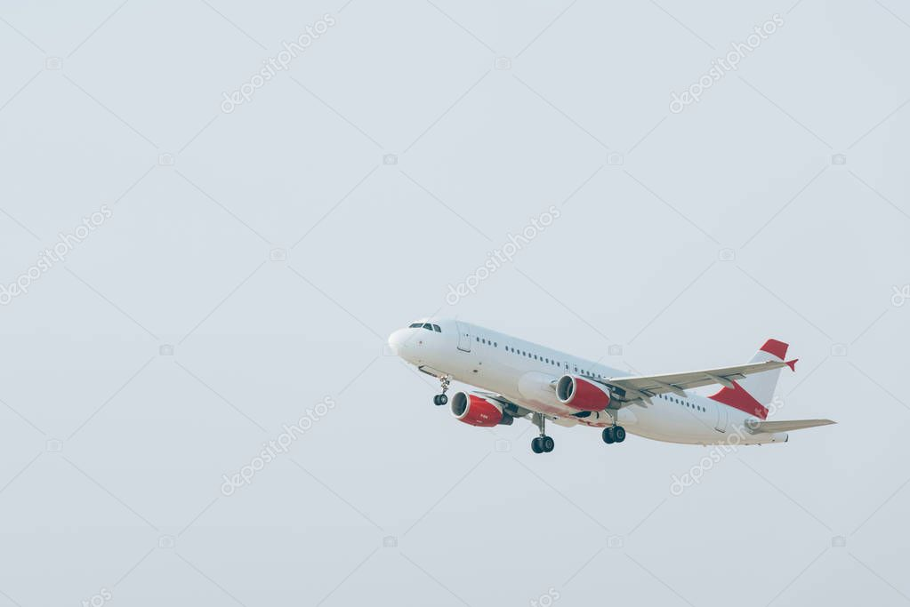 Aeroplane taking off with cloudy sky at background stock vector