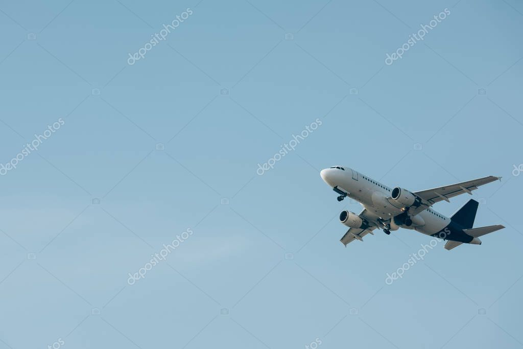 Commercial jet plane landing in blue sky stock vector