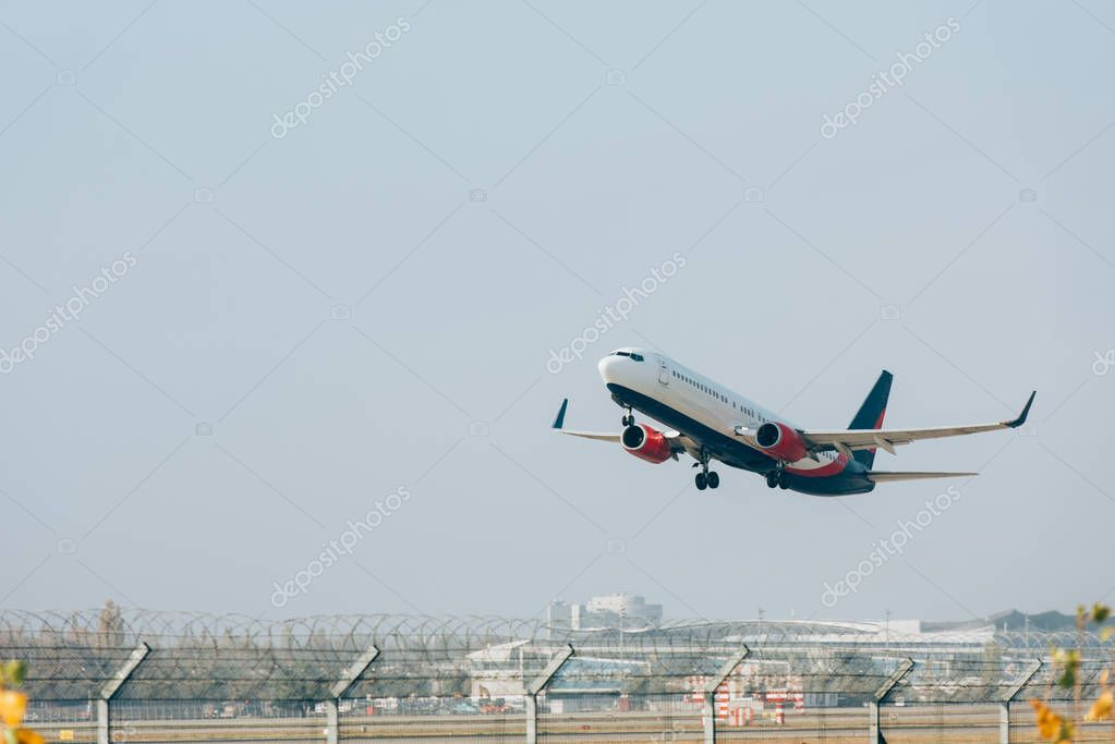 Jet liner landing on airport runway with blue sky at background stock vector