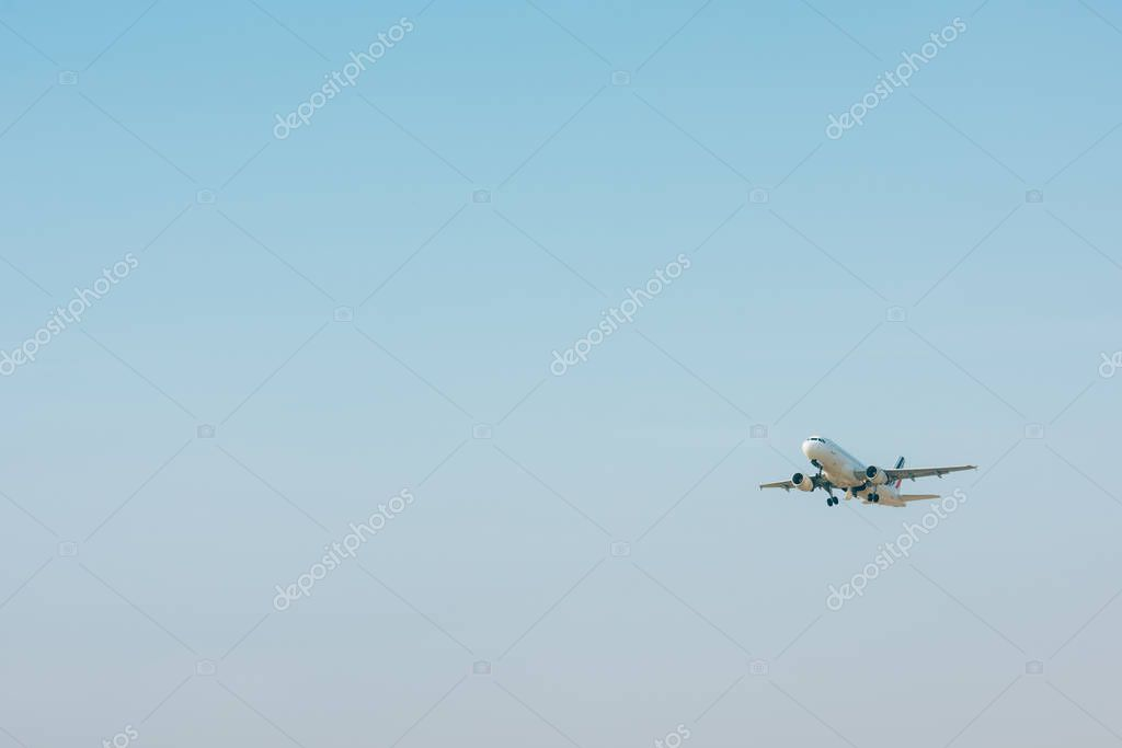 Airplane taking off in blue sky with copy space stock vector