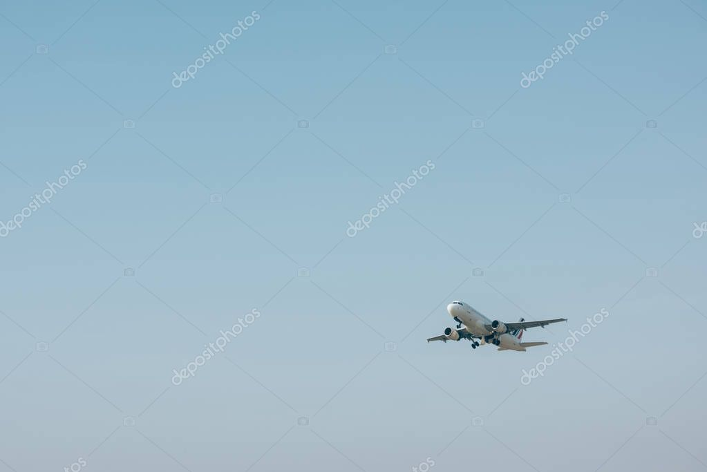 Flight departure of airplane in blue sky with copy space stock vector