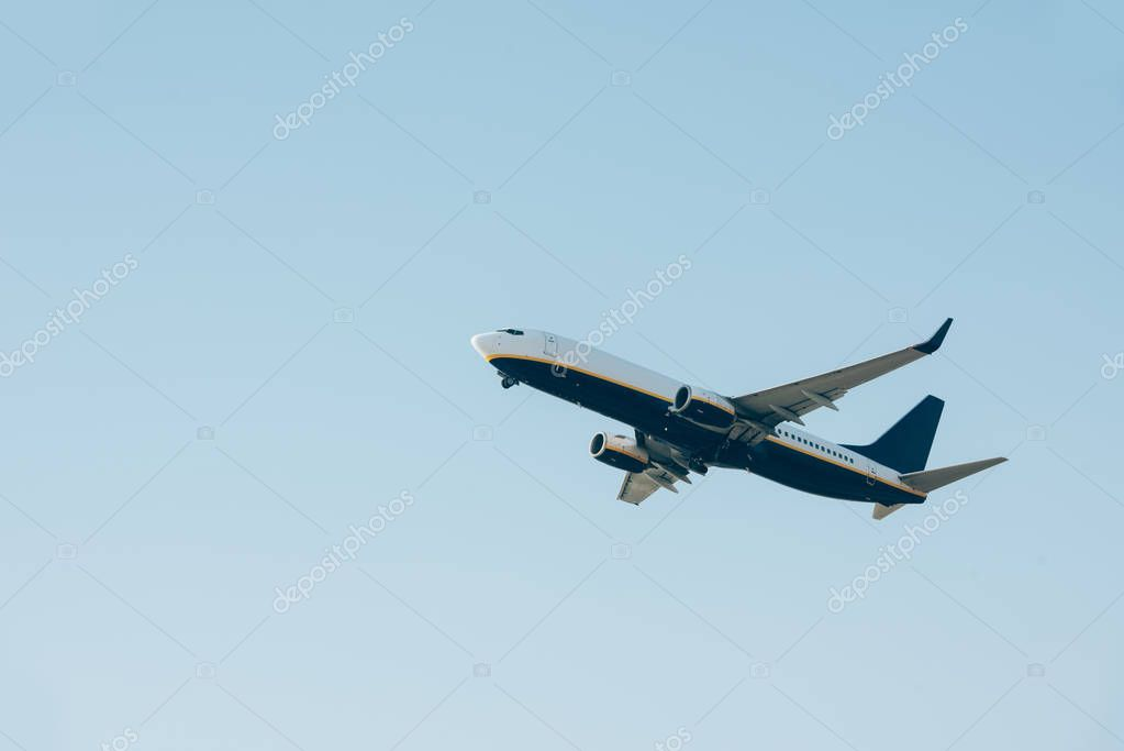 Low angle view of airplane departure in clear sky stock vector
