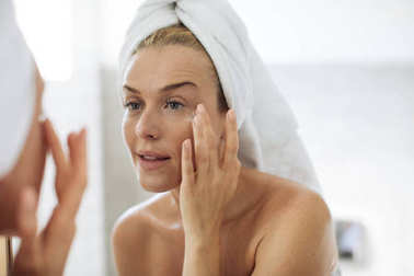 Woman Applying Moisturising Creme on Her Face