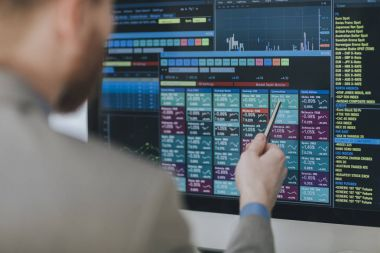 Stocks Broker Working With Forecast