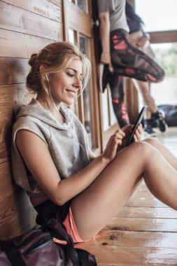 Sportswoman Listening to Music