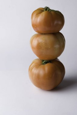 Three red tomatoes pile
