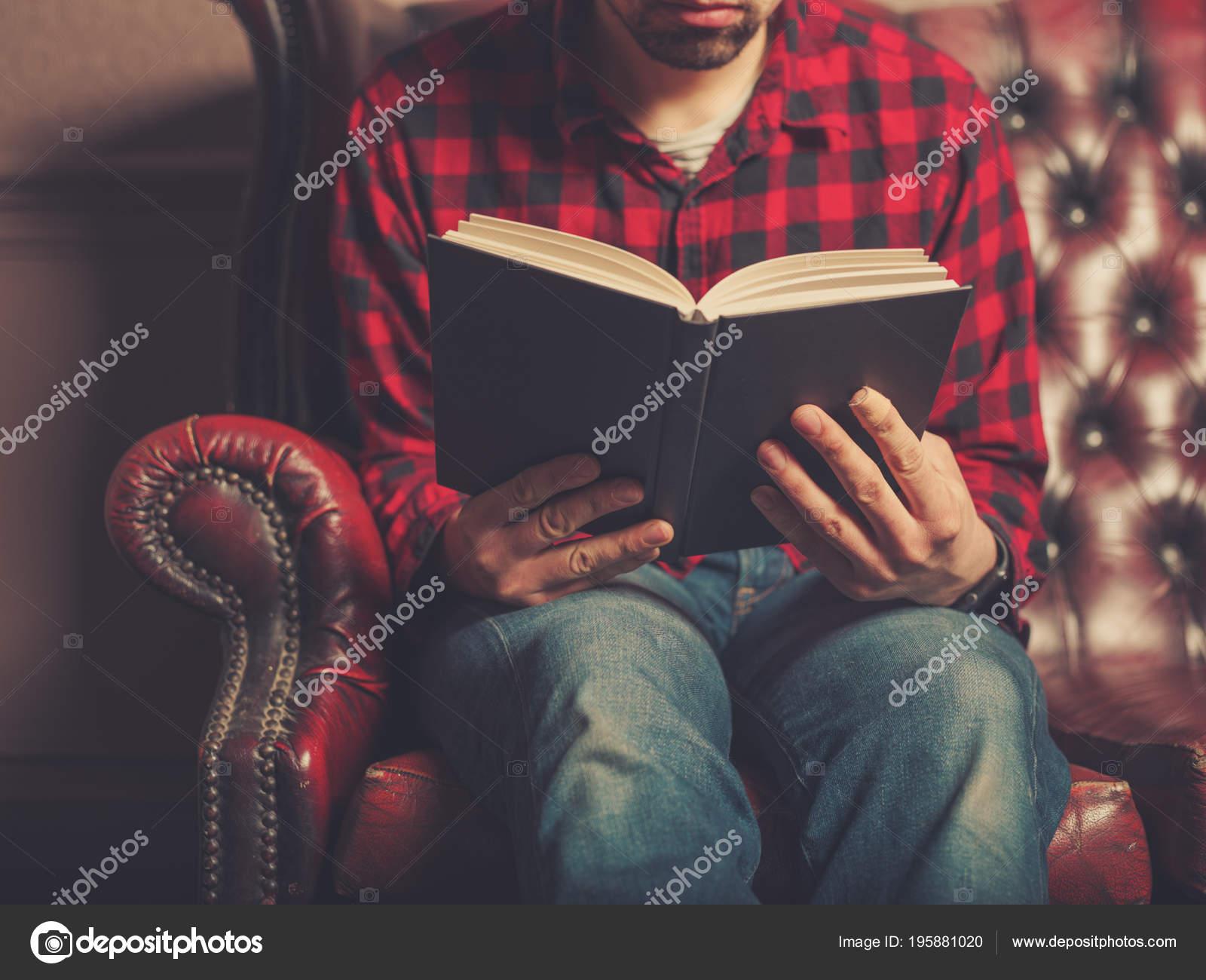 Young Man Sitting Leather Sofa Reading Book Stock Photo C Lofilolo