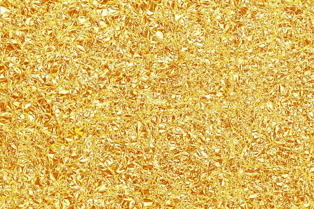 shiny yellow gold foil texture for background and shadow crease stock photo