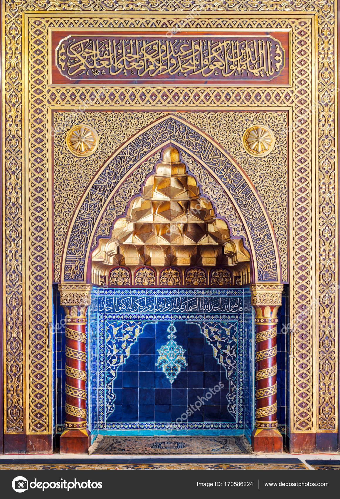 Golden ornate arched mihrab (niche) with floral pattern, blue ...