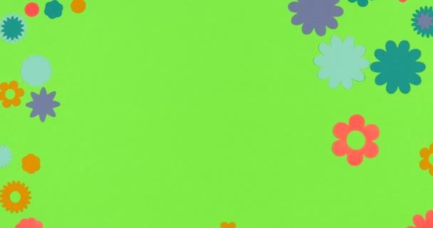 Animovaný zastavený pohyb. Papírové květiny scrapbooking rám formace na barevném pozadí.
