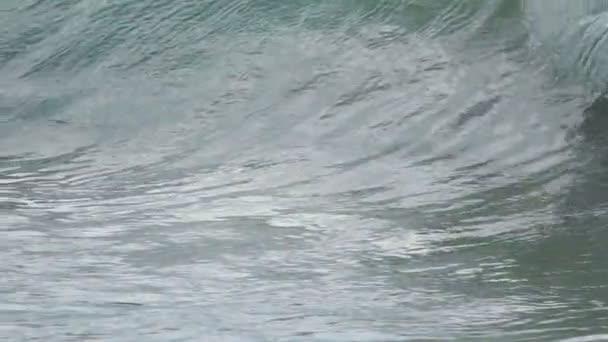Splashing turquoise ocean waves