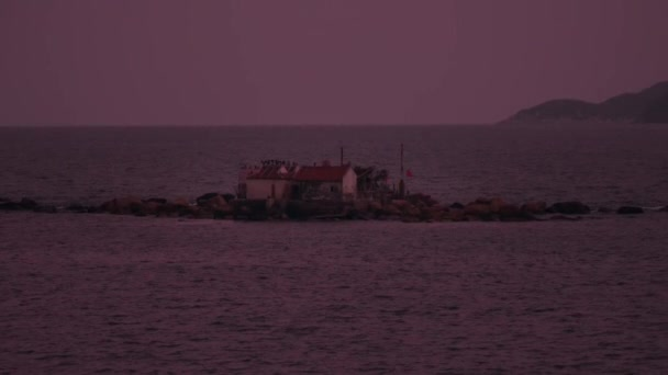 Lonely house on island during sunset