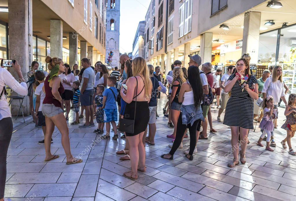 Tourists on the streets in the evening in the city of Zadar.