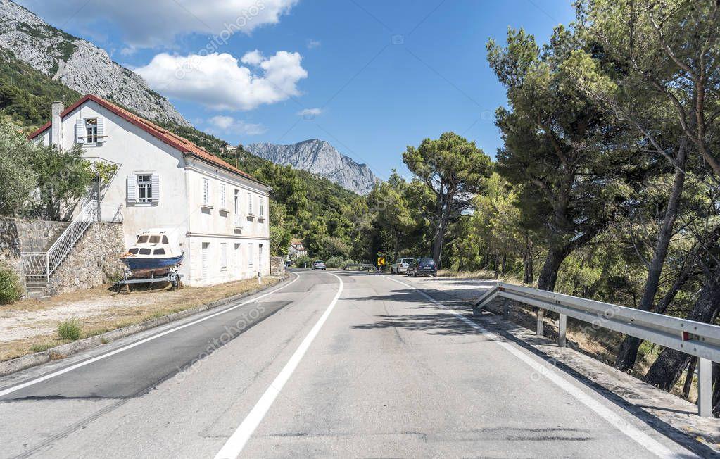 An automobile road along the sea coast of the resort area of Makarska Riviera in Croatia.