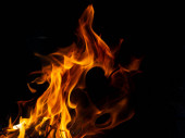 Hot fire with flames and black background