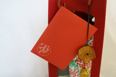 creative red gift box with red envelope, ribbon