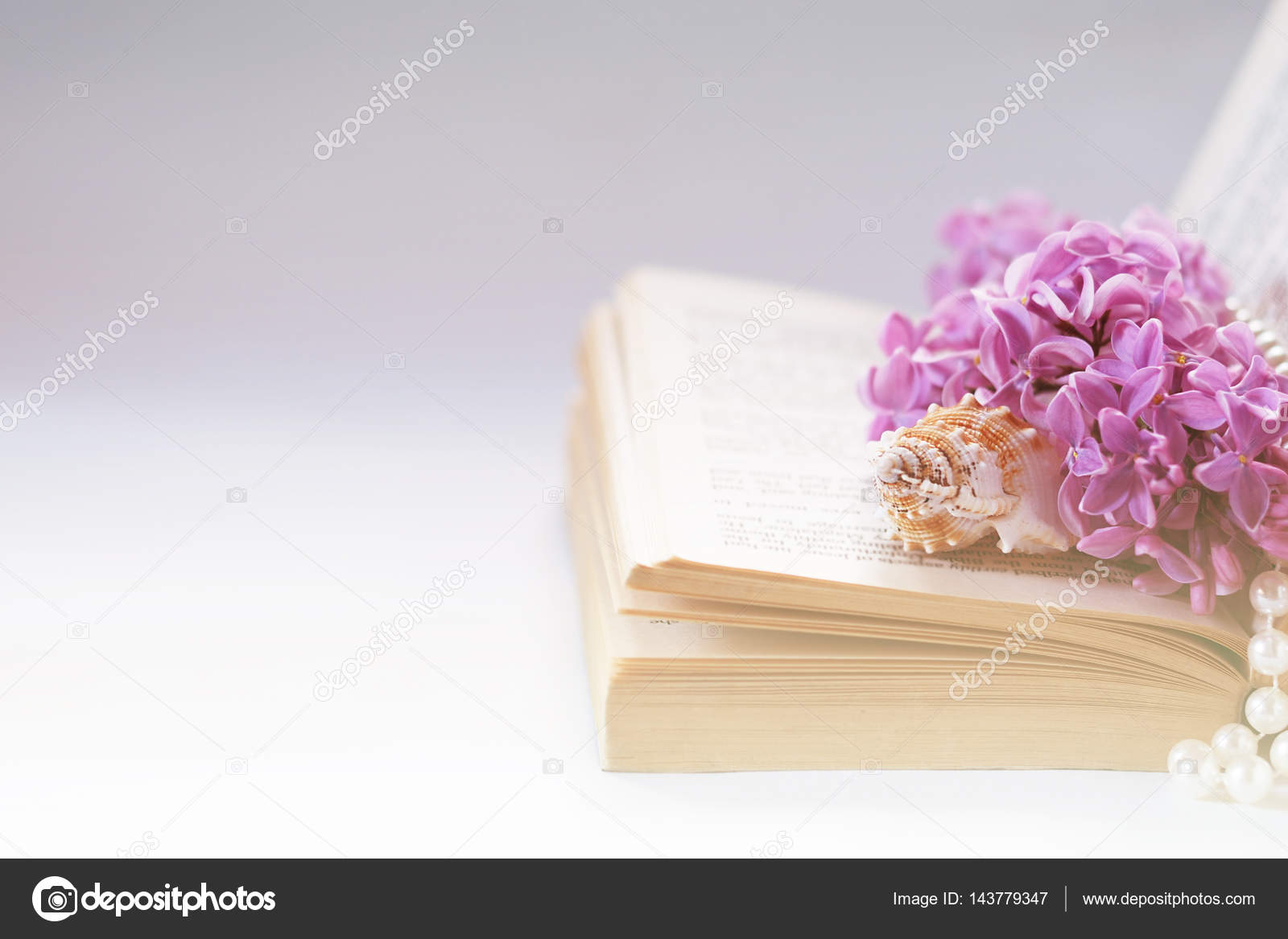 Vintage background with old book, lilac flower, and pearls. Romantic ...