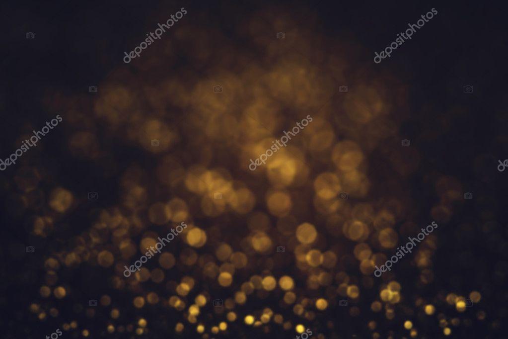 Dark glitter background with sparkling lights
