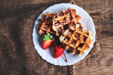 Belgian waffles topped with strawberries