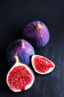 Fresh blue figs on  background.