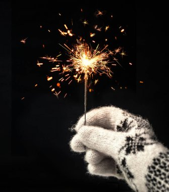 Hand holding beautiful sparkles