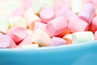 Colorful marshmallows in a blue bowl