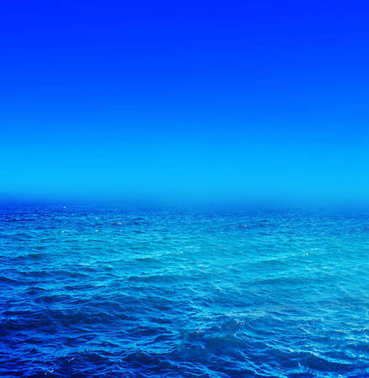 Panorama of sea waves. Landscape view of aqua blue sea and  blue sky and with sunny reflections