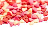 Fotografie Valentinstag Hintergrund mit Herzen auf weiß mit Exemplar. Das Konzept der Valentines Day Card Backen Dekorationen in Herzform - streut Zucker