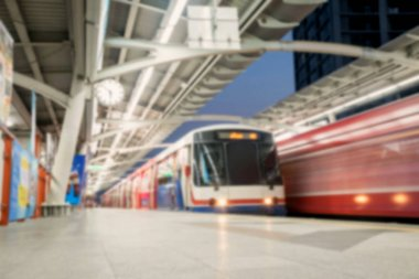 Blurred of BTS skytrain arrives to terminal station / BTS skytrain