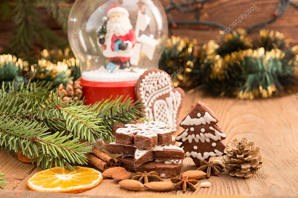 Christmas Gingerbread Cookies Against Background Sphere With San