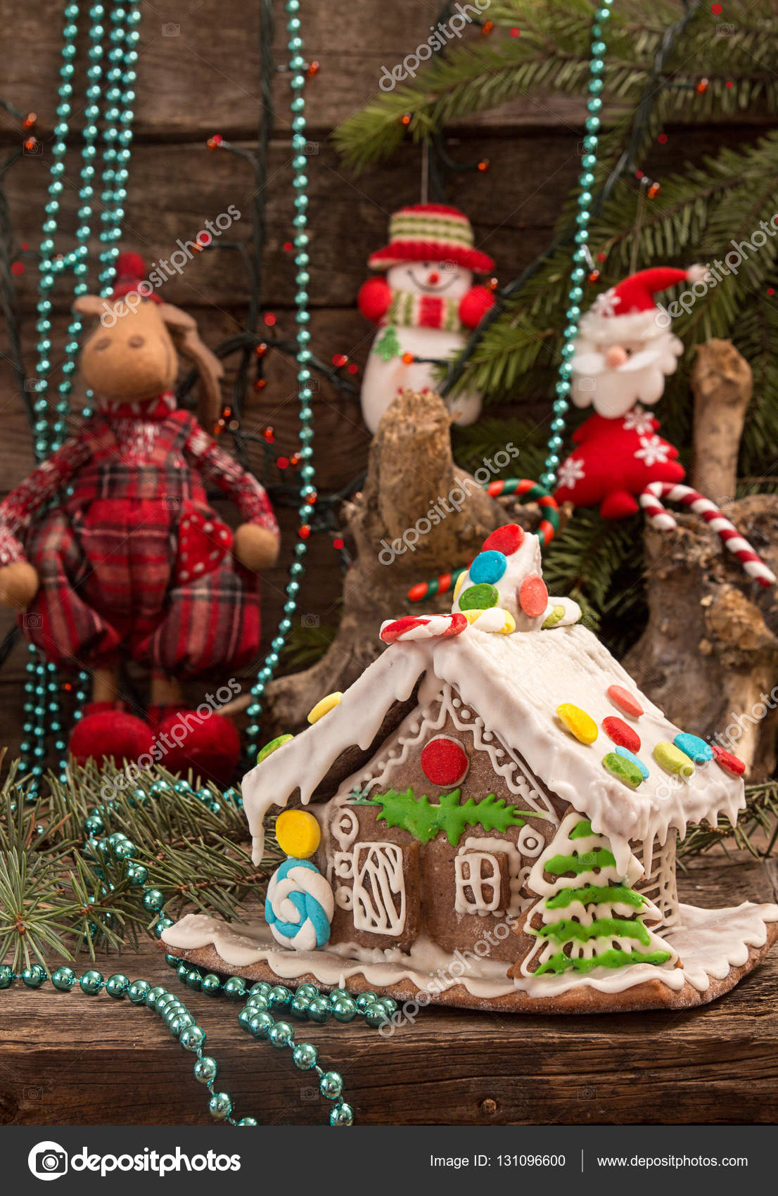 Christmas gingerbread house and holiday decorations on old