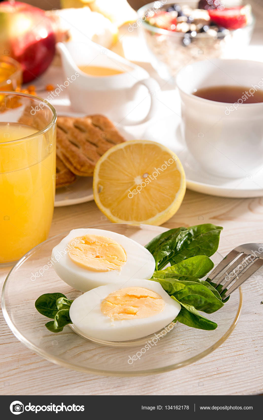 Healthy Breakfast Boiled Eggs With Spinach Cup Of Tea Orange Juice Cookies On White Table Organic Natural Food Concept Top View