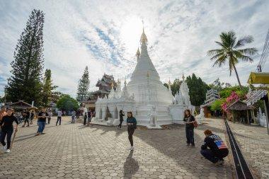 Many people visit Burmese-style chedi of Wat Phra That Doi Kong Mu