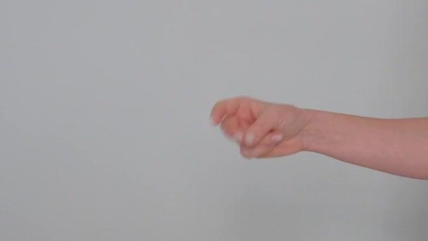 gesto prstu Evropana na bílém pozadí