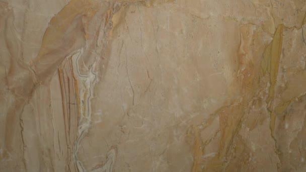 Close-up gyönyörű kő márvány bézs tónusú szilárd felületet a modern design befejezéséhez a konyha, fürdőszoba, belső dekoráció. Fényképezőgép csúszda