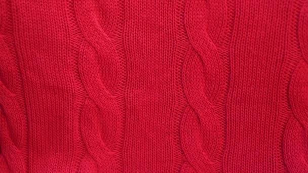 Közelkép egy piros kötött pamut szövet textúra, kamera dia