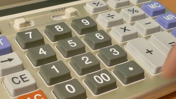 Typing numbers in office calculator, calculating financial operations, close-up
