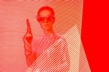 Spy Agent with Gun in Red and Yellow Light Painting Backdrop