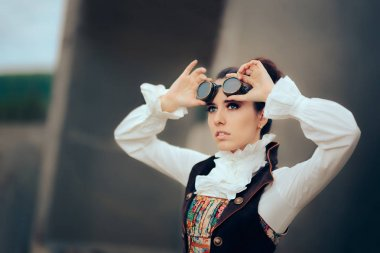 Steampunk woman wearing goggles