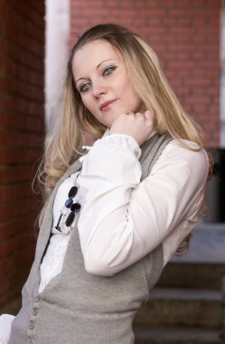 Youth Lifestyle Concepts and Ideas. Portrait of Young Smiling Caucasian Blond Woman Posing Relaxed