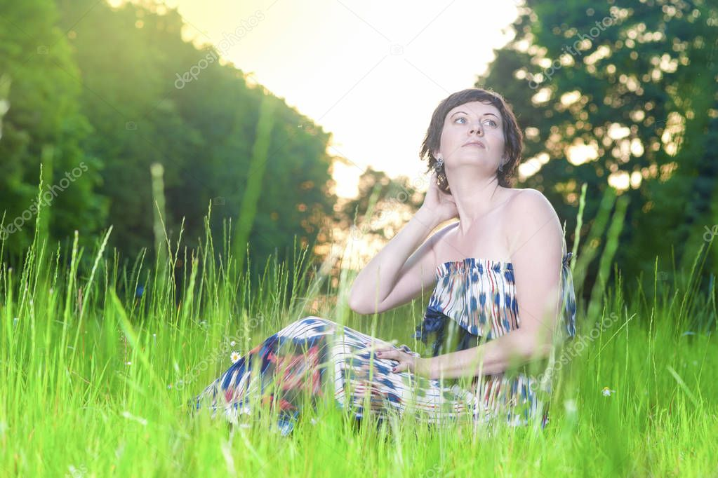 Portrait of Relaxing Caucasian Brunette Woman Posing Outdoors on Nature Background