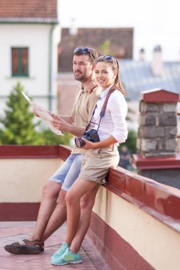 Travel Concepts. Young Caucasian Couple Traveling Through the City