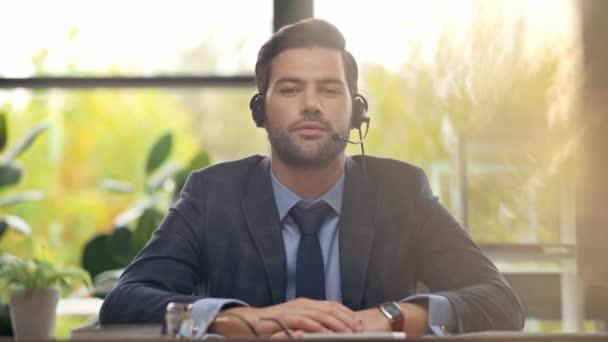 handsome operator in headset talking in office