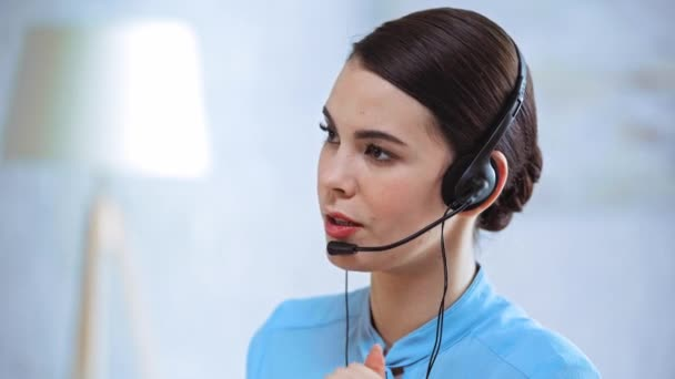 businesswoman in headset talking in call center